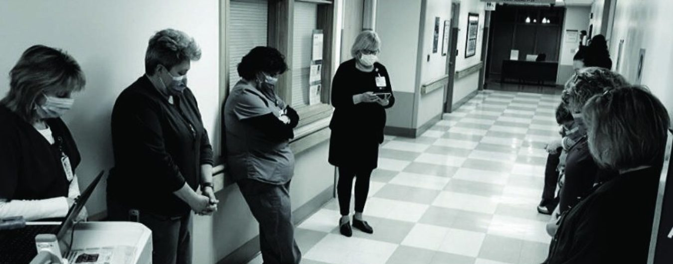Healthcare workers in a hallway