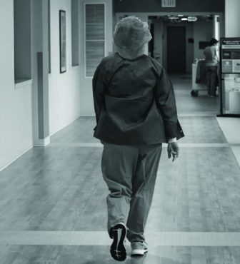Healthcare worker walking down the hall